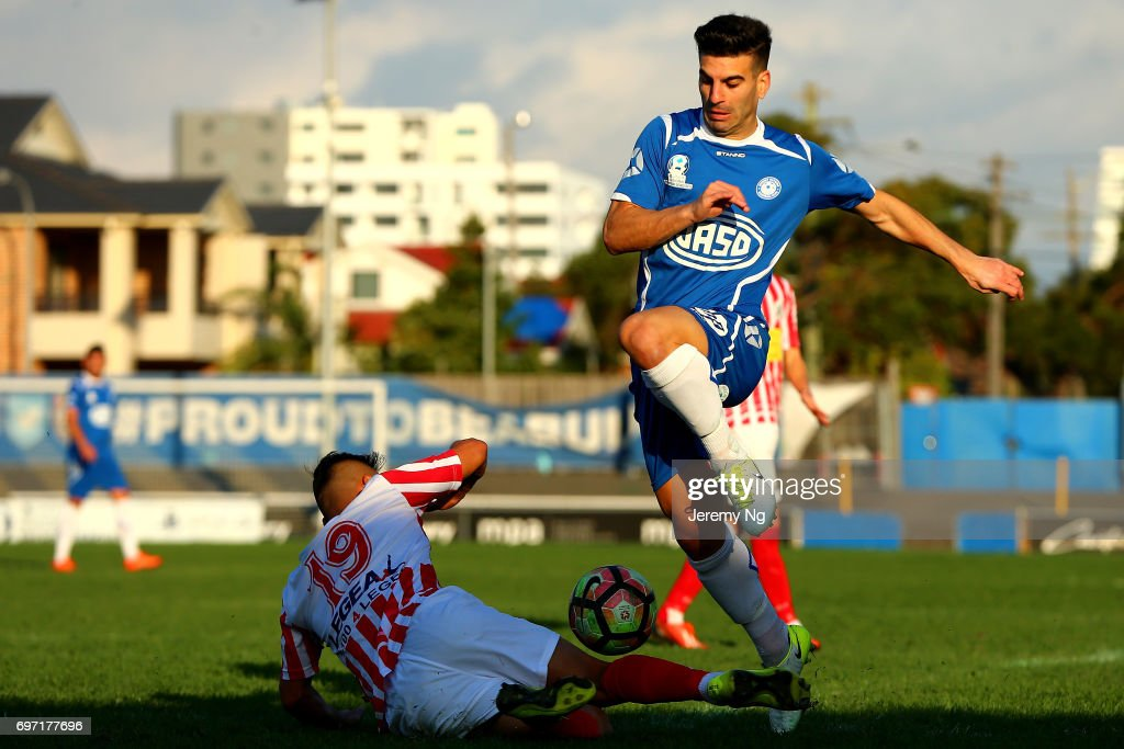 William Angel of Olympic FC and Lawrence Hanna of Parramatta FC challenge for the ball during the NSW NPL Men's match between Sydney Olympic FC and Parramatta FC on June 18, 2017 in Sydney, Australia.