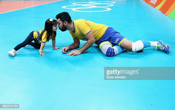 William Arjona of Brazil celebrates victory over Russia with his daughter during the Men's Volleyball Semifinal match on Day 14 of the Rio 2016...
