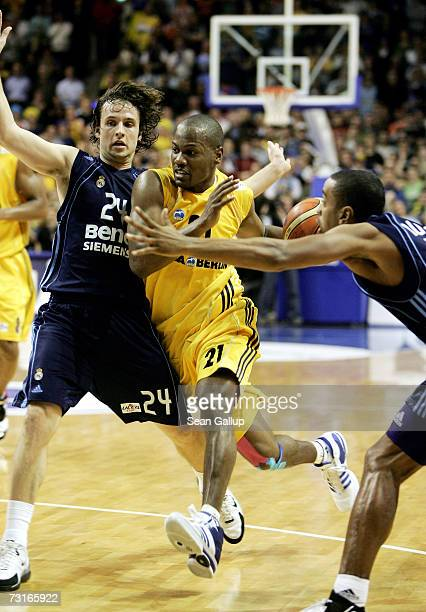 William Avery of Alba Berlin breaks past Raul Lopez and Louis Bullock of Real Madrid in the ULEB Cup Quarter Final Match between Alba Berlin and Real...