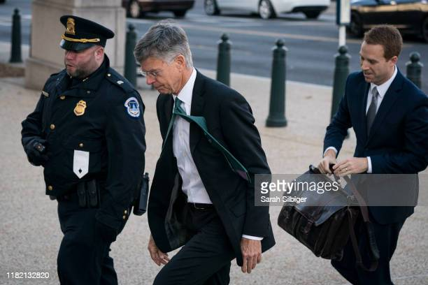 William B Taylor Jr the top diplomat in Ukraine arrives to the Longworth House Office Building to appear before the House Intelligence Committee on...