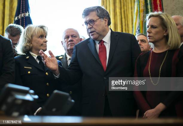 William Barr US attorney general speaks as Kirstjen Nielsen US secretary of Homeland Security listens during a veto signing with US President Donald...