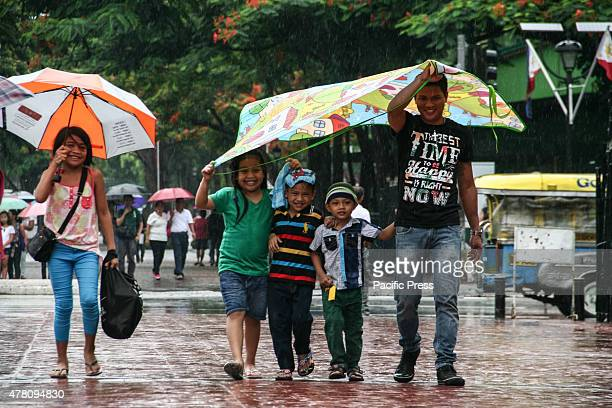 William Berdaje from Navotas City brought his young son with his nephew and nieces to the Rizal Park to celebrate Father's Day This year's Father's...