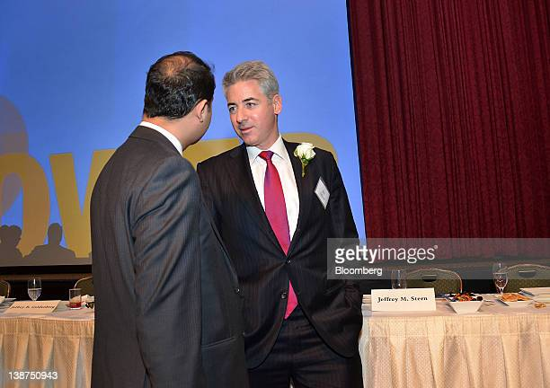 William Bill Ackman founder and chief executive officer of Pershing Square Capital Management LP right speaks to an attendee during the UJAFederation...