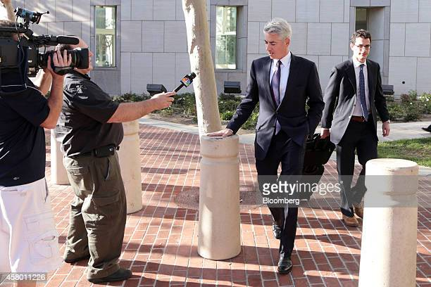 """William """"Bill"""" Ackman, founder and chief executive officer of Pershing Square Capital Management LP, center, speaks with members of the media after..."""