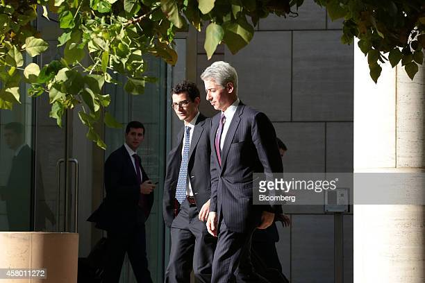 """William """"Bill"""" Ackman, founder and chief executive officer of Pershing Square Capital Management LP, right, leaves the federal court in Santa Ana,..."""