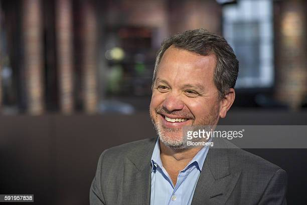 William Bill McGlashan founder and managing partner of TPG Growth LLC smiles during a Bloomberg West television interview in San Francisco California...