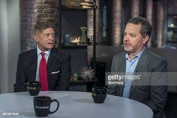 William Bill McGlashan founder and managing partner of TPG Growth LLC right speaks as Richard Bob Simonds chief executive officer at STX Productions...