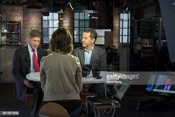 William Bill McGlashan founder and managing partner of TPG Growth LLC right listens as Richard Bob Simonds chief executive officer at STX Productions...