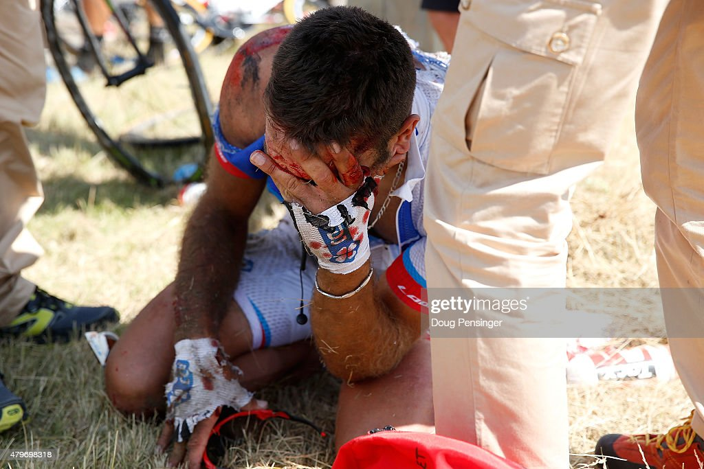 William Bonnet of France riding for FDJ is attended to after being involved in a crash with 65km remaining in stage three of the 2015 Tour de France from Anvers to Huy on July 6, 2015 in Huy, Belgium.