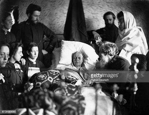 William Booth the founder of the Salvation Army kneels at the bedside of his dying wife Catherine