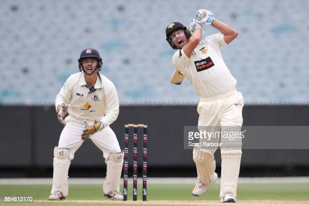 William Bosisto of Western Australia bats as wicketkeeper Seb Gotch of Victoria looks on during day one of the Sheffield Shield match between...