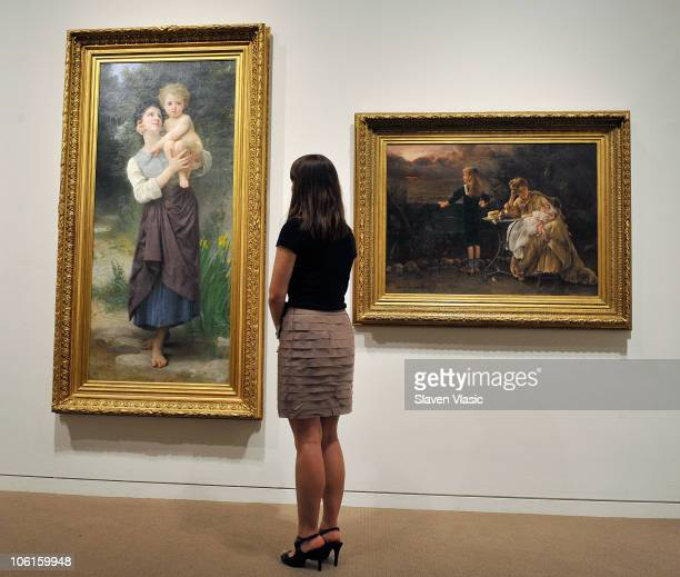 William Bouguereau's 'Frere et Soeur' and Alfred Stevens' 'Mere et ses Enfants' paintings on display at the press preview of paintings from the...