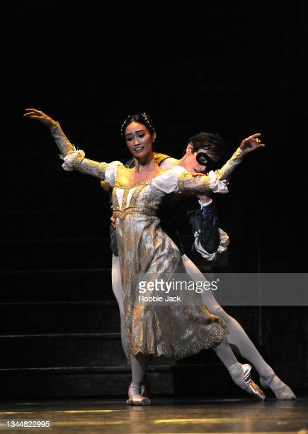 """William Bracewell as Romeo and Fumi Kaneko as Juliet with artists of the company in The Royal Ballet's production of Kenneth MacMillan's """"Romeo And..."""