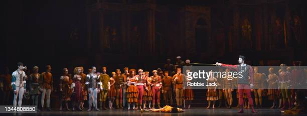 """William Bracewell as Romeo and Ryoichi Hirano as Tybalt with artists of the company in The Royal Ballet's production of Kenneth MacMillan's """"Romeo..."""
