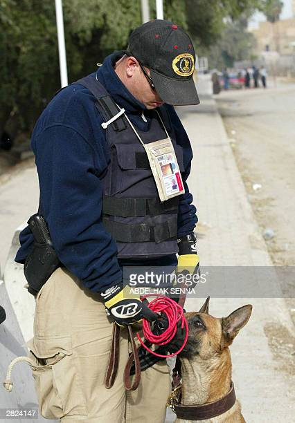 William Brant a US police officer holds an explosive detonator found near the entrance of the Sheraton and Palestine hotels 20 December 2003 in...
