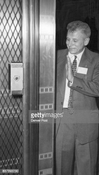 William Bruns Otis Elevator Co research engineer demon­strates his 'sixth sense' elevator door The pilotless Autronic door is controlled with an...