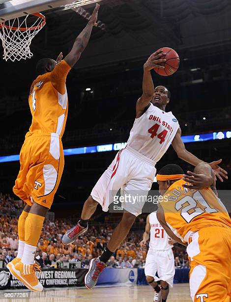 William Buford of the Ohio State Buckeyes goes up for a shot as Melvin Goins and Wayne Chism of the Tennessee Volunteers defend during the midwest...