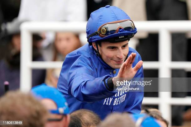 William Buick celebrates after riding Pinatubo to win The Darley Dewhurst Stakes at Newmarket Racecourse on October 12 2019 in Newmarket England