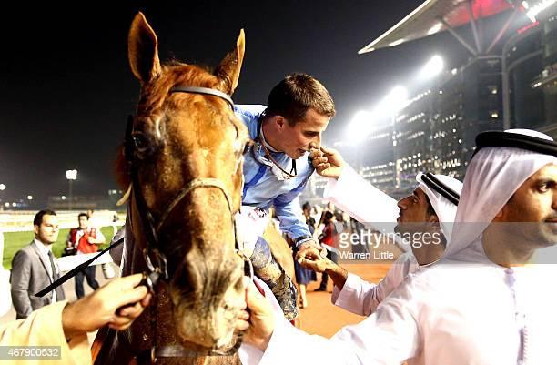 William Buick is congratulated by Hamdan bin Mohammed bin Rashid Al Maktoum Crown Prince of Dubai after winning the Dubai World Cup on Prince Bishop...