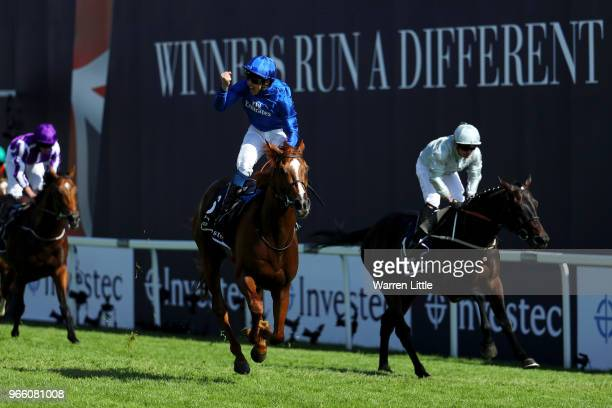 William Buick ridding Masar celebrates crossing the line and winning the Investec Derby race on Derby Day at Epsom Downs on June 2, 2018 in Epsom,...