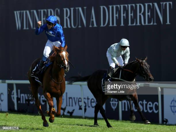 William Buick ridding Masar celebrates crossing the line and winning the Investec Derby race on Derby Day at Epsom Downs on June 2 2018 in Epsom...