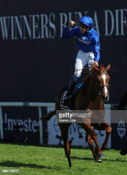 William Buick ridding Masar celebrates crossing the line and winning the Investec Derby during the Investec Epsom Derby Day at Epsom Downs on June 2...