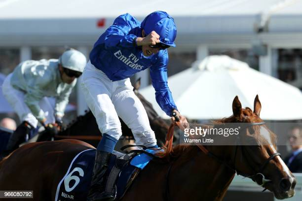 William Buick ridding Masar celebrates winning the Investec Derby race on Derby Day at Epsom Downs on June 2 2018 in Epsom England