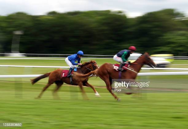 William Buick riding Albahr on their way to winning the Watch Racing TV Now Novice Stakes at Haydock Park Racecourse on June 9, 2021 in...