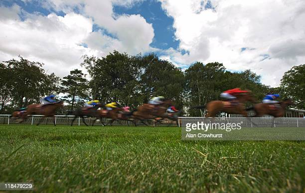 William Buick riding Instance win The Piper-Heidsieck Champagne Irish EBF Fillies' Handicap Stakes at Newmarket racecourse on July 08, 2011 in...