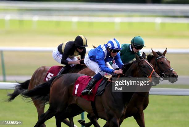 William Buick riding Mandoob on their way to winning the Racing To School Novice Stakes at Haydock Park Racecourse on June 9, 2021 in...