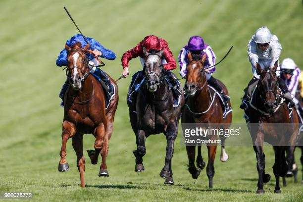 William Buick riding Masar win The Investec Derby from Dee Ex Bee during Investec Derby Day at Epsom Downs Racecourse on June 2, 2018 in Epsom,...