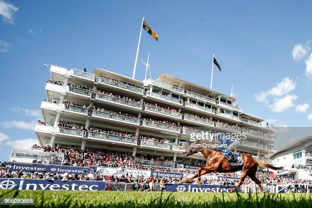 William Buick riding Masar wins The Investec Derby during Investec Derby Day at Epsom Downs Racecourse on June 2, 2018 in Epsom, United Kingdom.