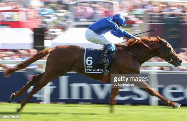 William Buick riding Masar wins The Investec Derby Race run during Investec Derby Day at Epsom Downs Racecourse on June 2 2018 in Epsom England