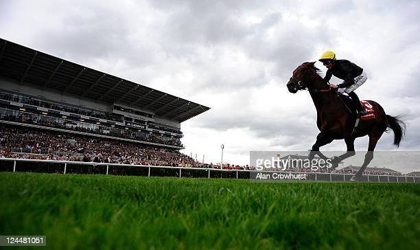 William Buick riding Masked Marvel win The Ladbrokes St. Leger Stakes at Doncaster racecourse on September 10, 2011 in Doncaster, England.