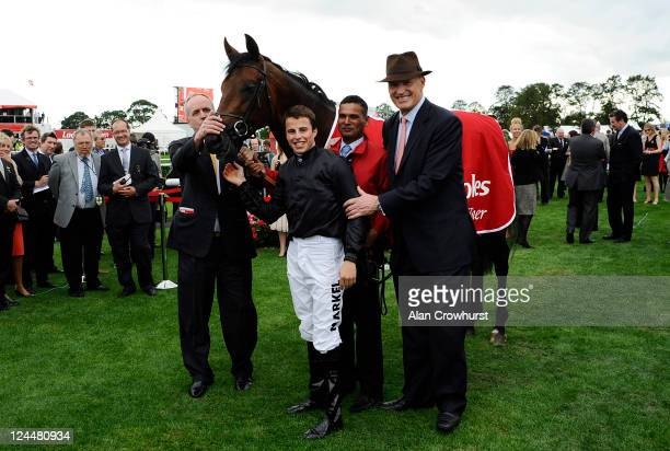 William Buick riding Masked Marvel with trainer John Gosden win The Ladbrokes St Leger Stakes at Doncaster racecourse on September 10 2011 in...