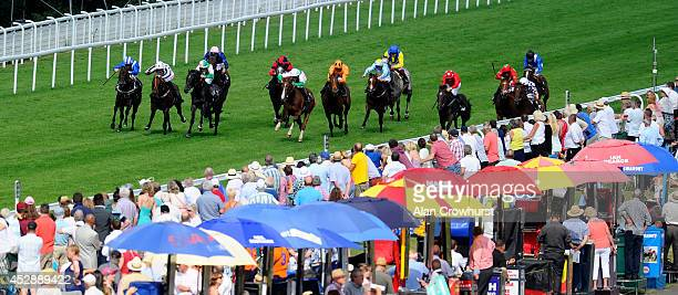 William Buick riding Misleading wins the bet365 EBF Maiden Stakes at Goodwood racecourse on July 29 2014 in Chichester England
