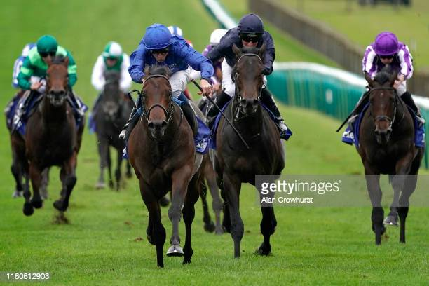William Buick riding Pinatubo win The Darley Dewhurst Stakes from Arizona and Seamie Heffernan at Newmarket Racecourse on October 12 2019 in...