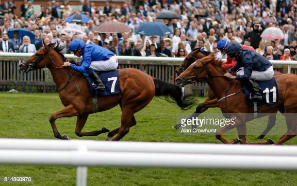 William Buick riding Poetic Charm win The Rossdales EBF Stallions Maiden Filliesâ Stakes at Newmarket racecourse on July 15 2017 in Newmarket England