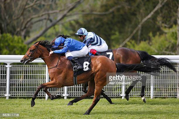 William Buick riding Skiffle win The Veolia Height Of Fashion Stakes from The Black Princess and Frankie Dettori at Goodwood racecourse on May 19...