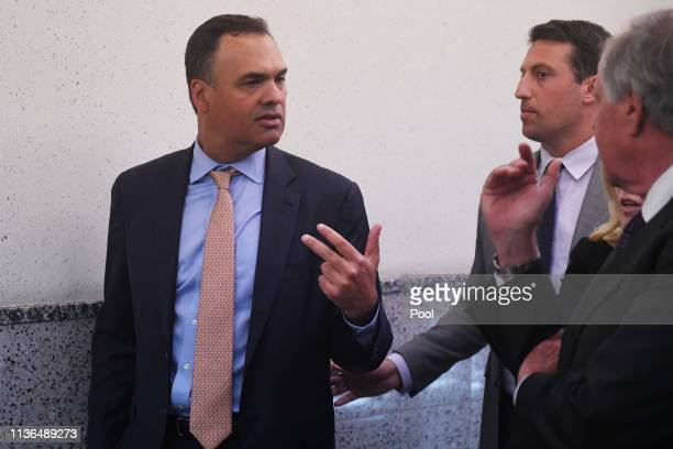 William Burck Alex Spiro and Jack Goldberger the defense team for New England Patriots owner Robert Kraft emerge from a court hearing on Friday...