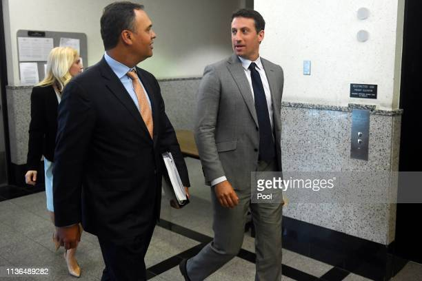 William Burck and Alex Spiro part of the defense team for New England Patriots owner Robert Kraft emerge from a court hearing on Friday regarding...