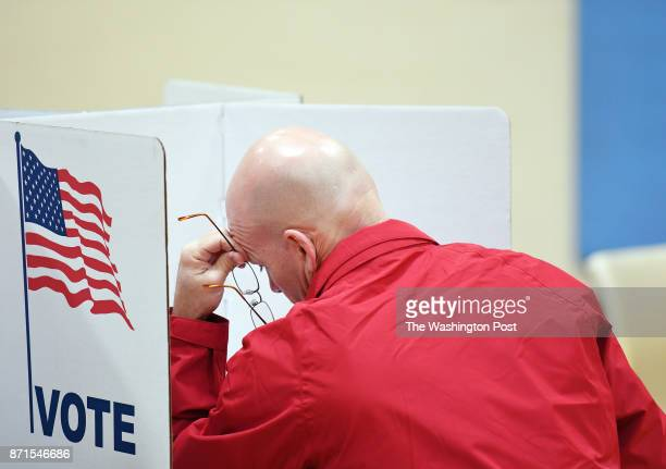 William Burdett votes at Washington Mill Elementary School on Tuesday November 07 2017 in Alexandria VA