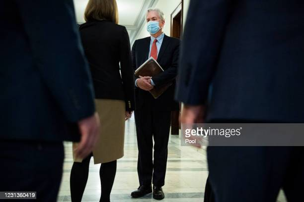 William Burns, right, nominee for Central Intelligence Agency director, is seen after the conclusion of his Senate Select Intelligence Committee...