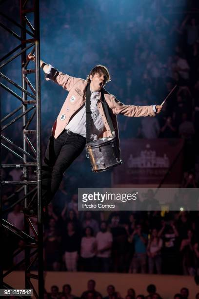 William Butler of Arcade Fire climbs one of the stage towers during the bands performance at Campo Pequeno on April 23 2018 in Lisbon Portugal