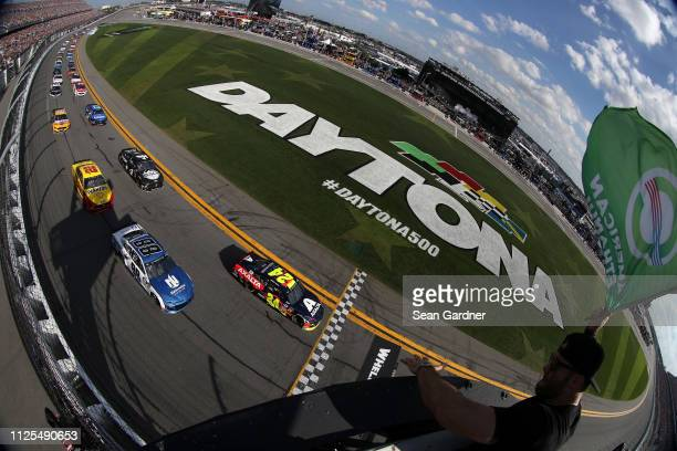 William Byron driver of the Axalta Chevrolet and Alex Bowman driver of the Nationwide Chevrolet lead the field during the Monster Energy NASCAR Cup...