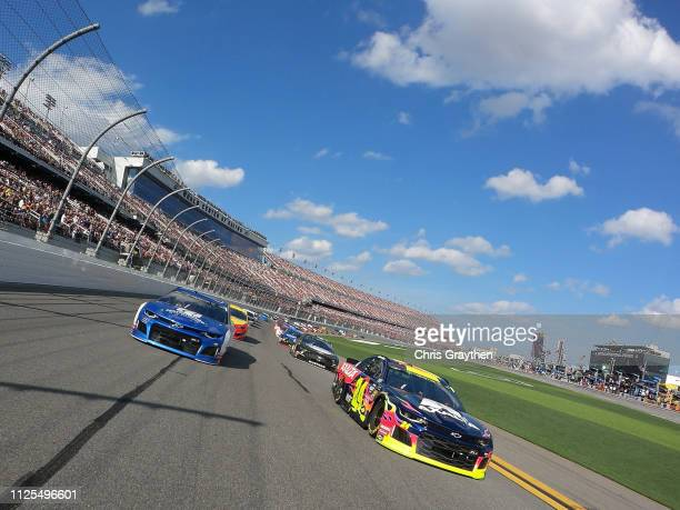 William Byron driver of the Axalta Chevrolet and Alex Bowman driver of the Nationwide Chevrolet lead the field during pace laps prior to the start of...