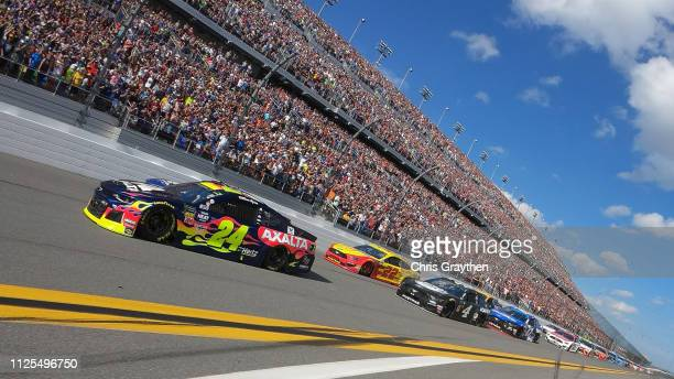 William Byron driver of the Axalta Chevrolet leads the field during the start of the Monster Energy NASCAR Cup Series 61st Annual Daytona 500 at...