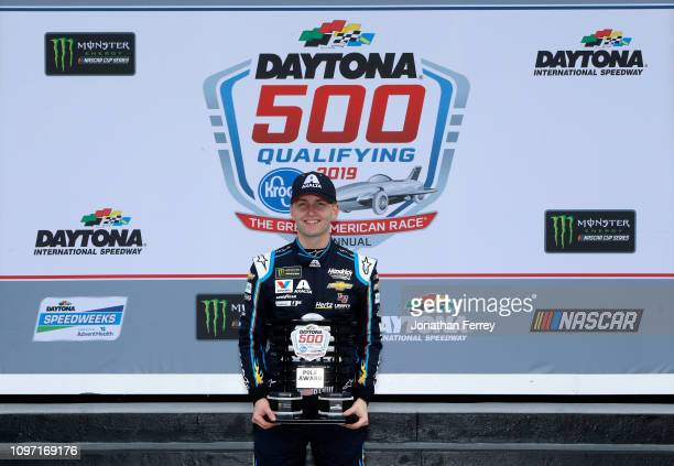 William Byron driver of the Axalta Chevrolet poses for a photo after winning the pole award during qualifying for the Monster Energy NASCAR Cup...