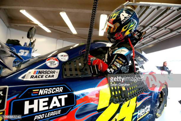 William Byron driver of the Axalta Chevrolet sits in his car during practice for the Monster Energy NASCAR Cup Series 61st Annual Daytona 500 at...