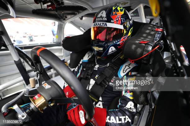 William Byron driver of the Axalta Chevrolet sits in his car during practice for the Monster Energy NASCAR Cup Series Food City 500 at Bristol Motor...